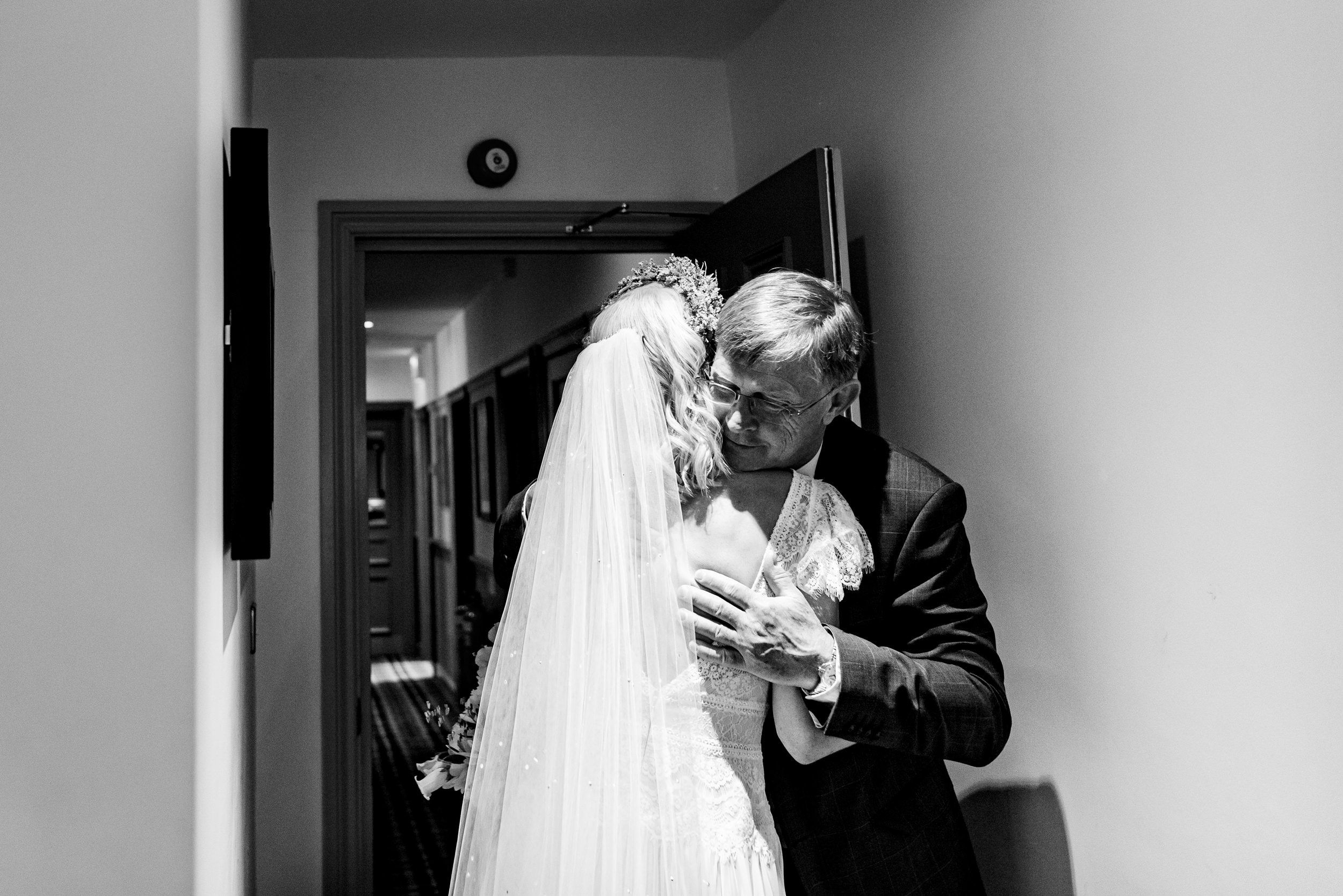 bride and her father hugging. maybush wedding co wedding photography by emma and rich.