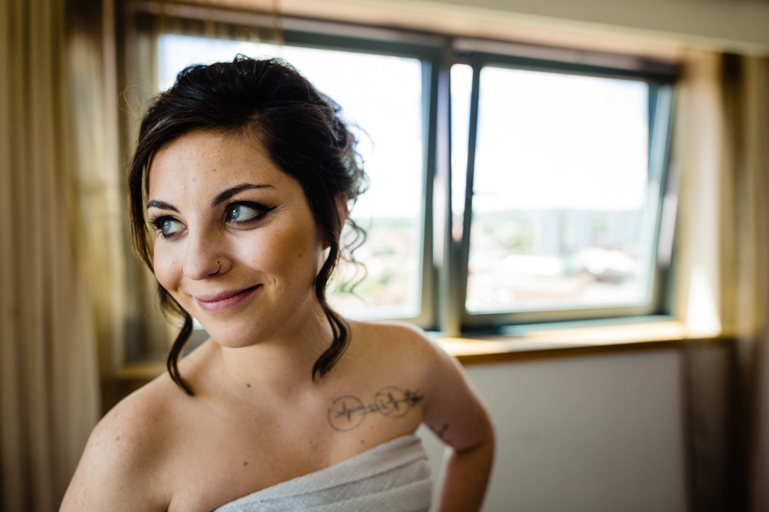bride smiling before she leaves for ceremony. plough inn, hathersage wedding photography by emma and rich.