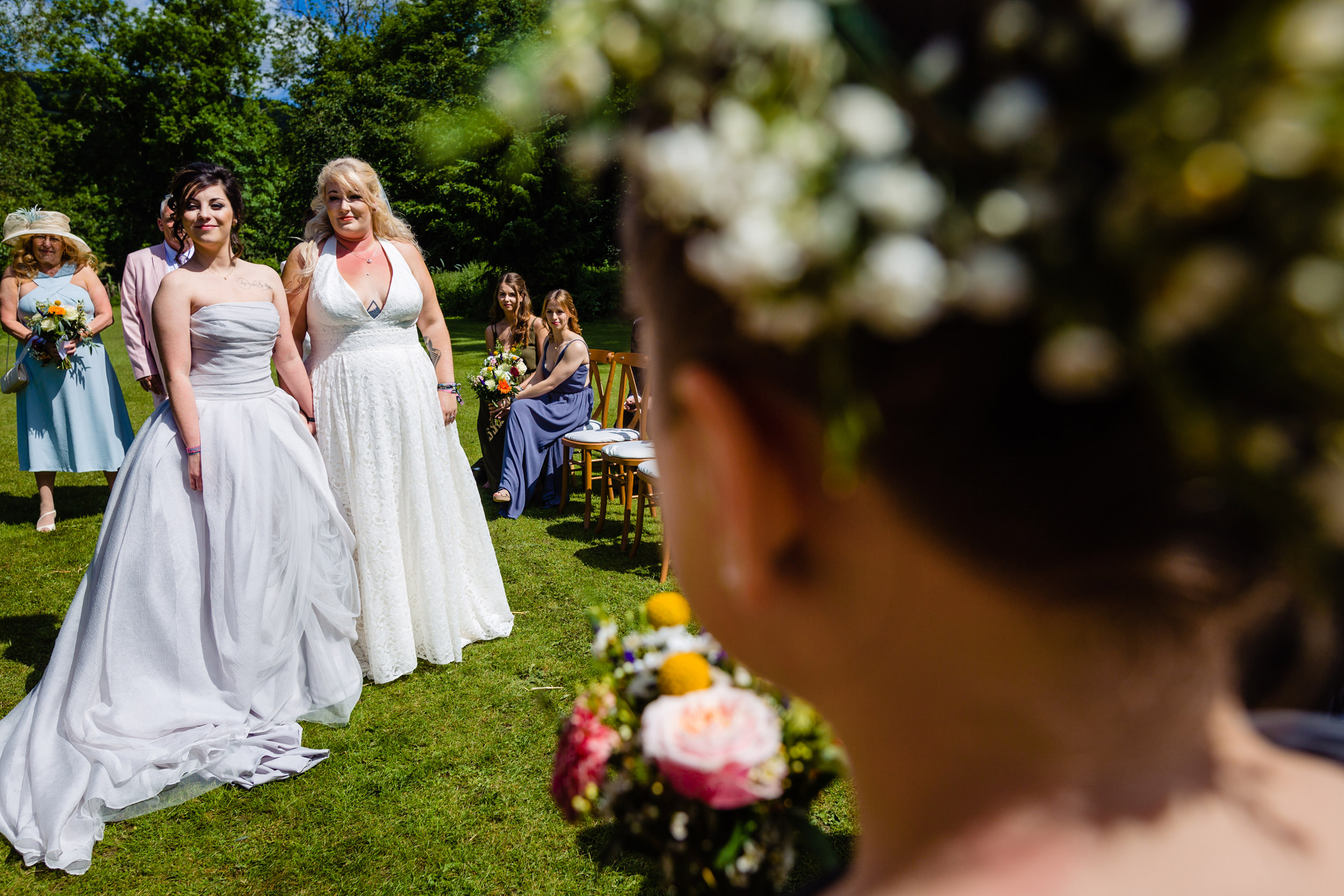 two brides listen to their bridesmaid's reading. plough inn, hathersage wedding photography by emma and rich.