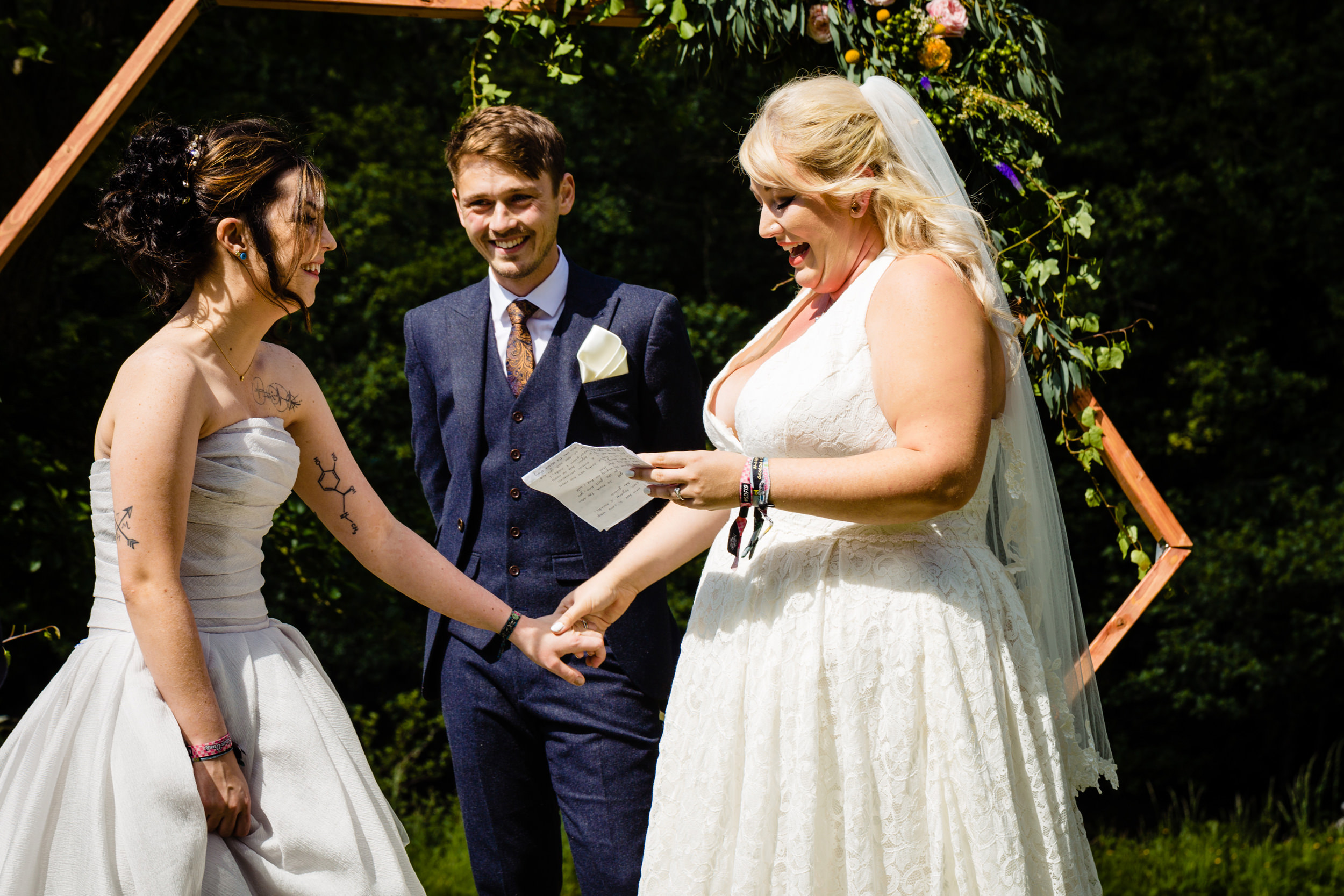 brides laughing as they exchange vows. plough inn, hathersage wedding photography by emma and rich.