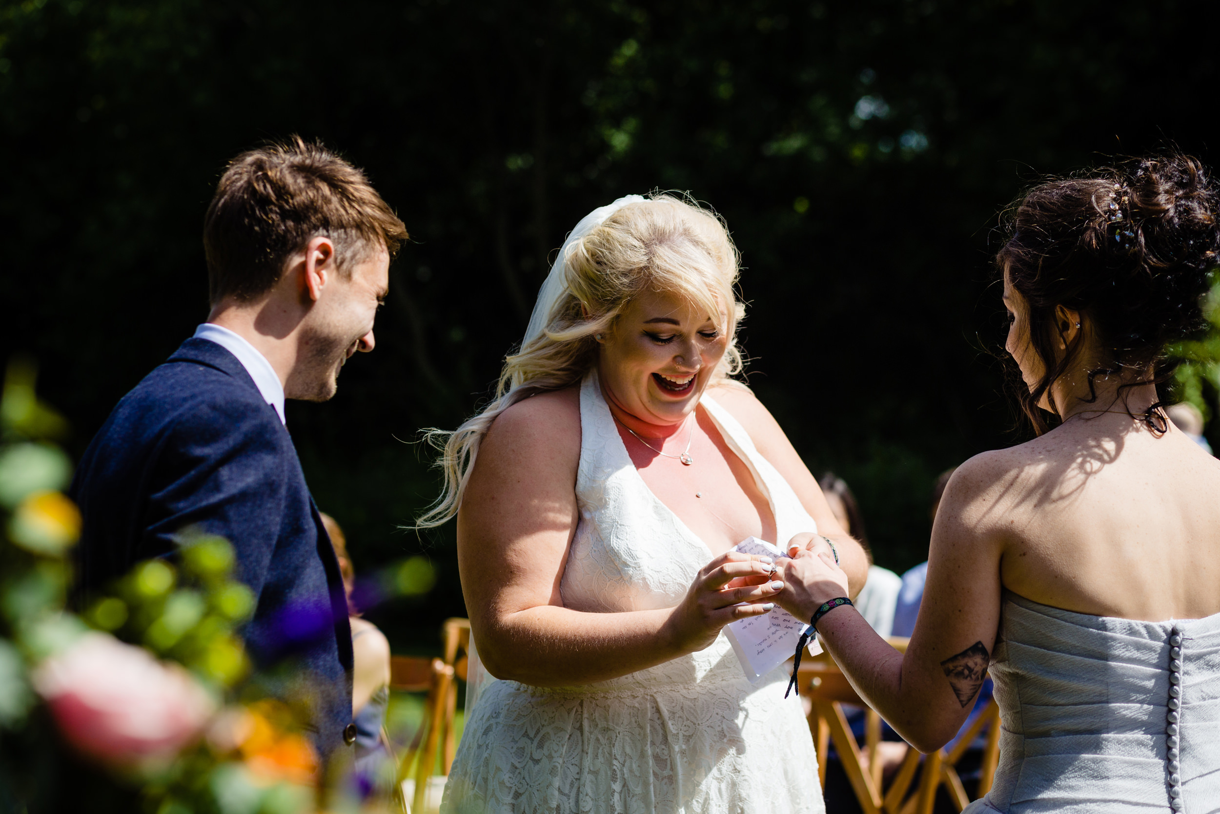 brides exchanging rings. plough inn, hathersage wedding photography by emma and rich.