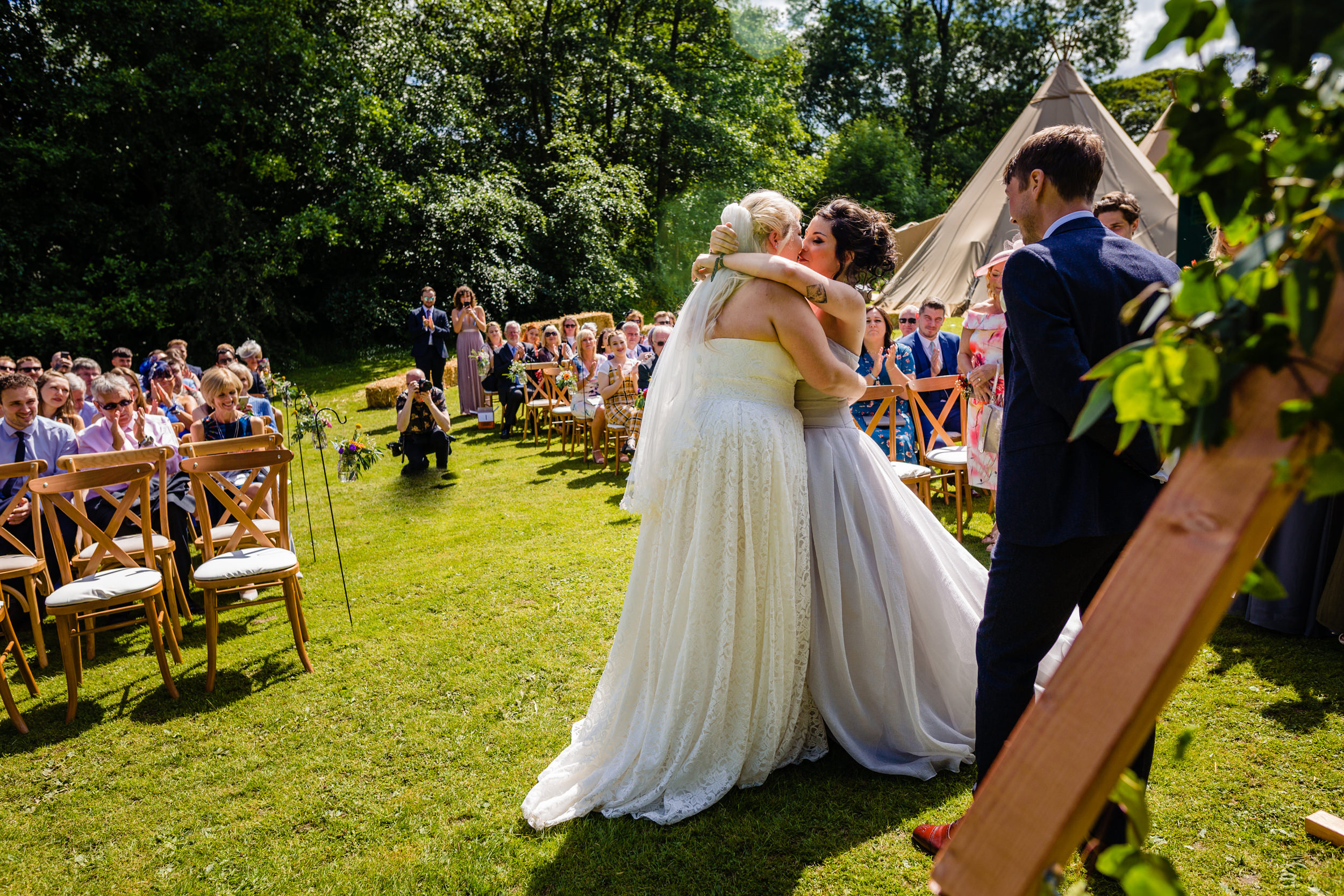 brides first kiss at wedding. plough inn, hathersage wedding photography by emma and rich.