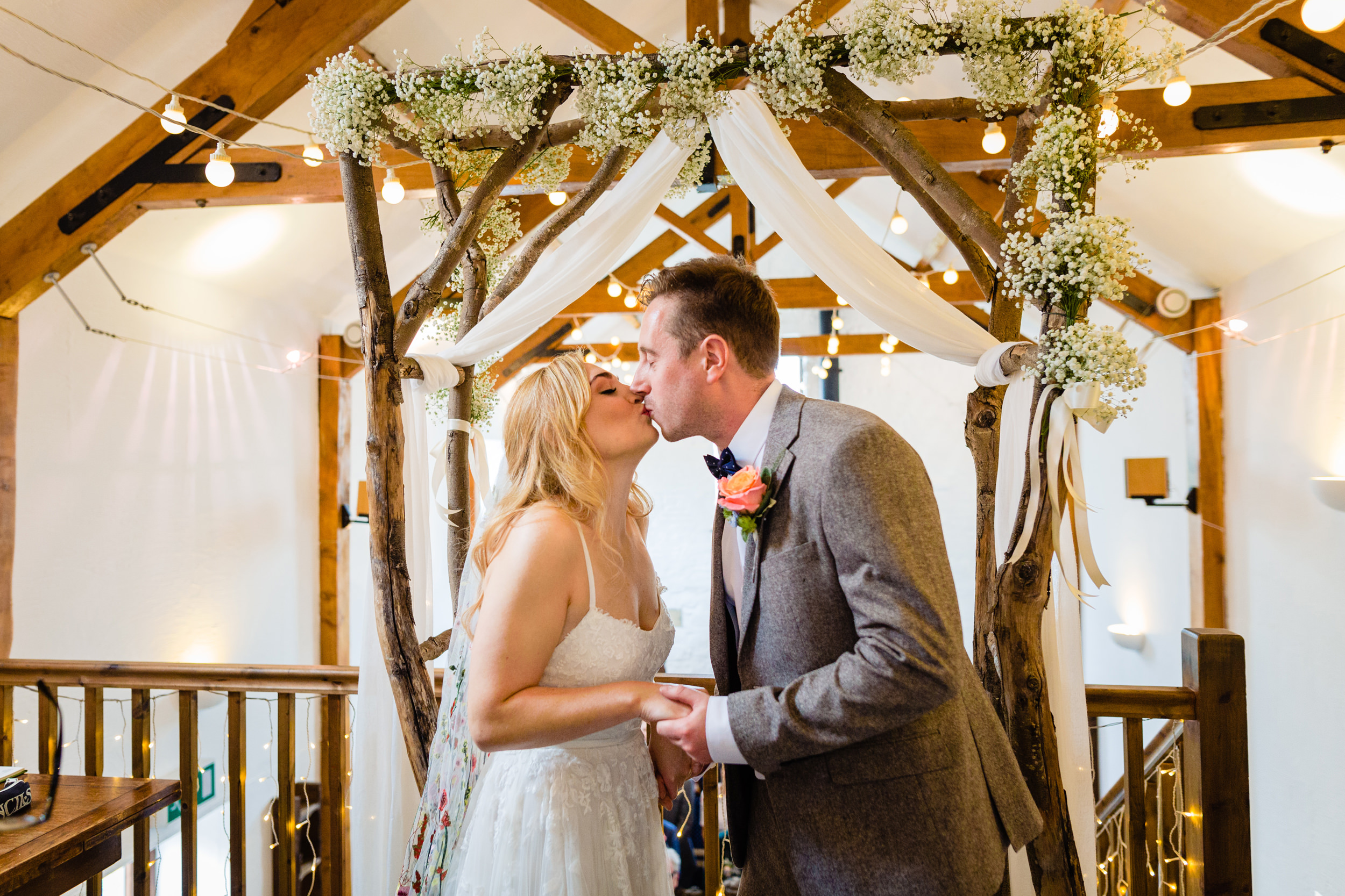 bride and grooms first kiss. wildwood and eden wedding photography by emma and rich.