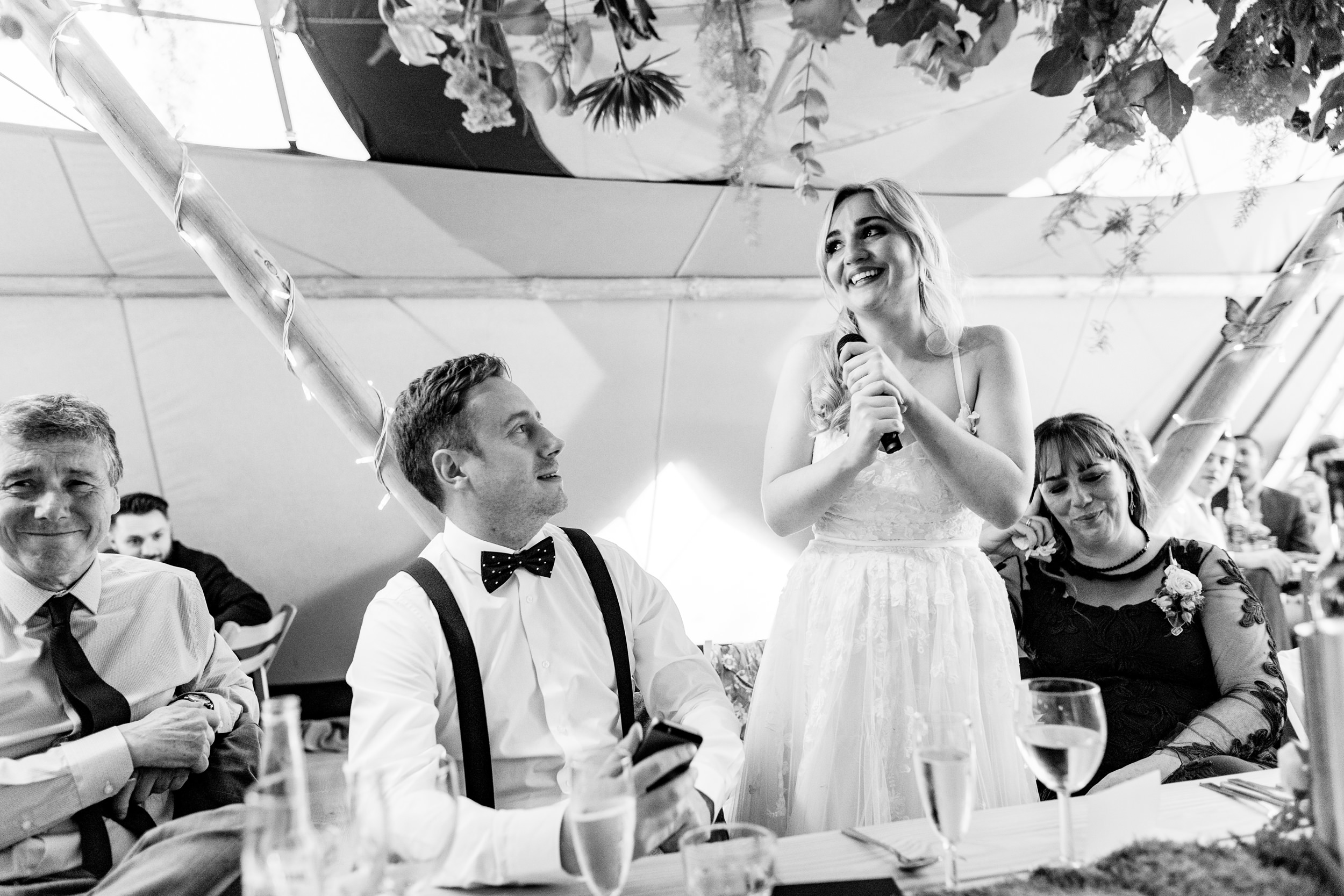 bride giving a speech. wildwood and eden wedding photography by emma and rich.