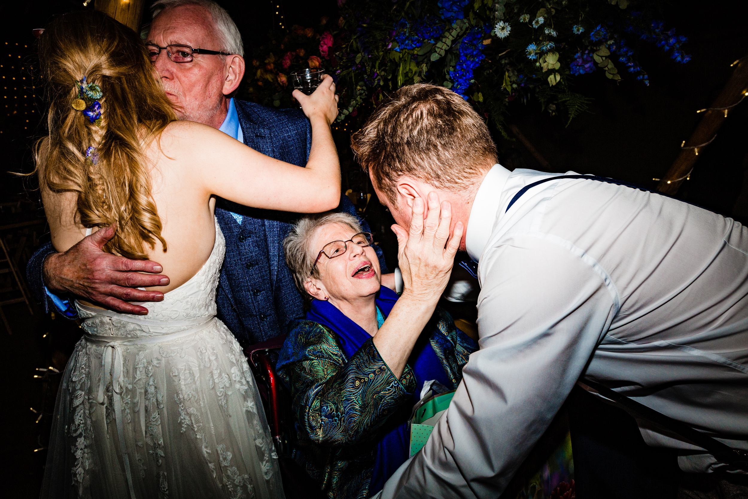 bride and groom say goodbye to grandparents at wedding reception. wildwood and eden wedding photography by emma and rich.
