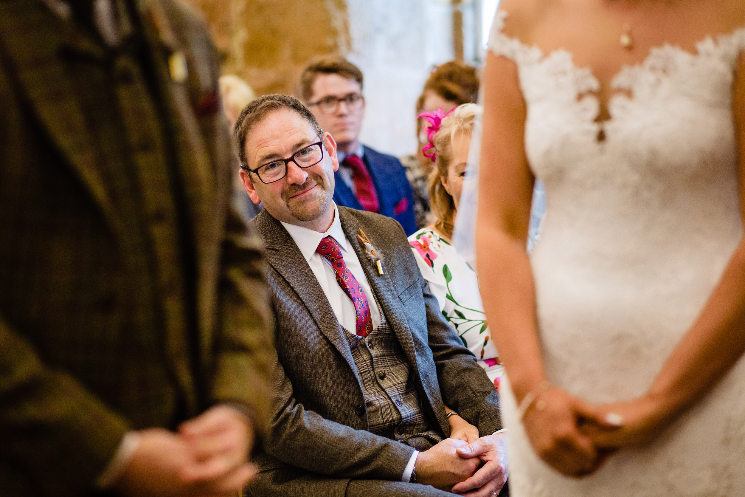 father watching daughter get married. esk valley wedding photography by emma and rich.