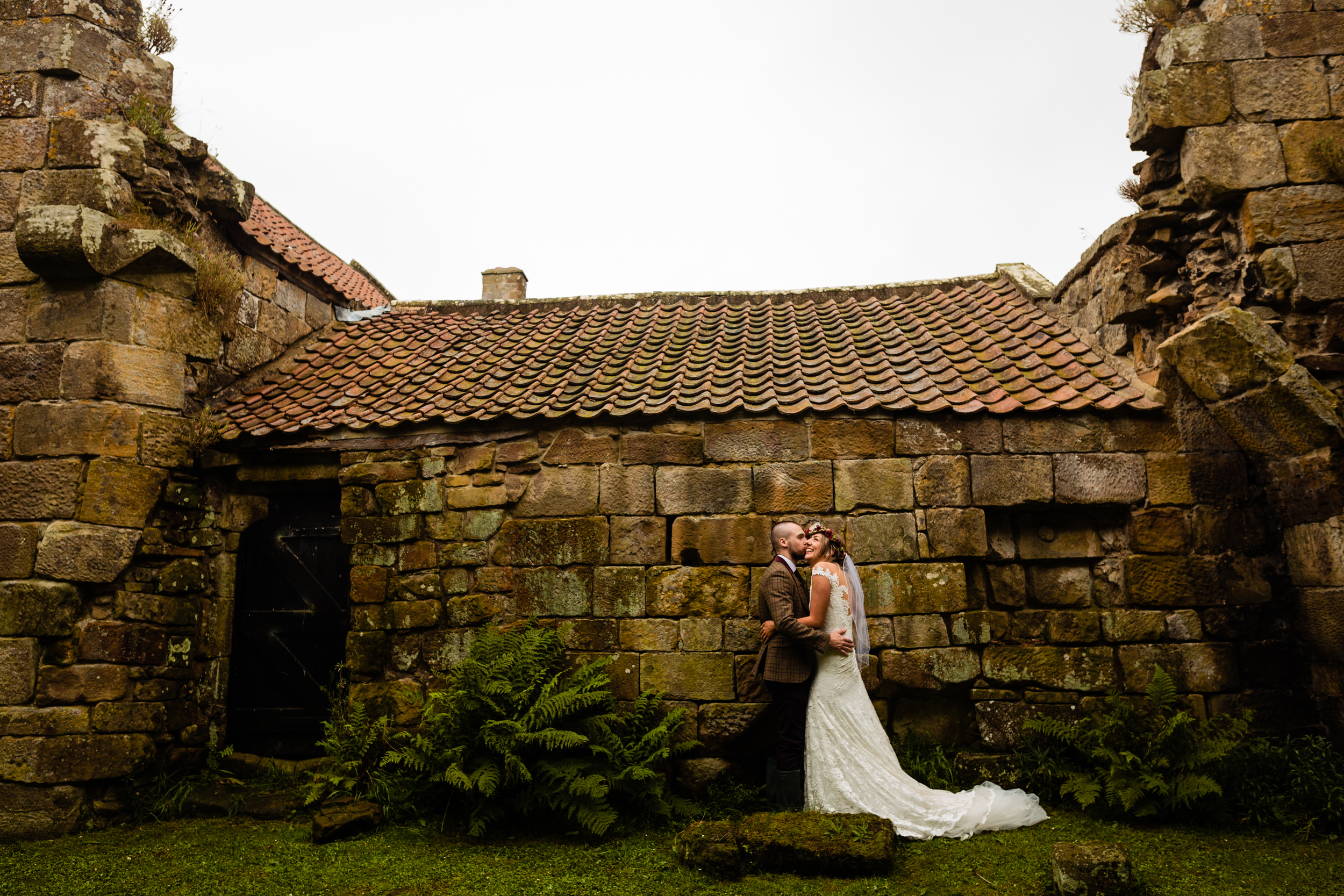 bride and groom in castle ruins. esk valley wedding photography by emma and rich.