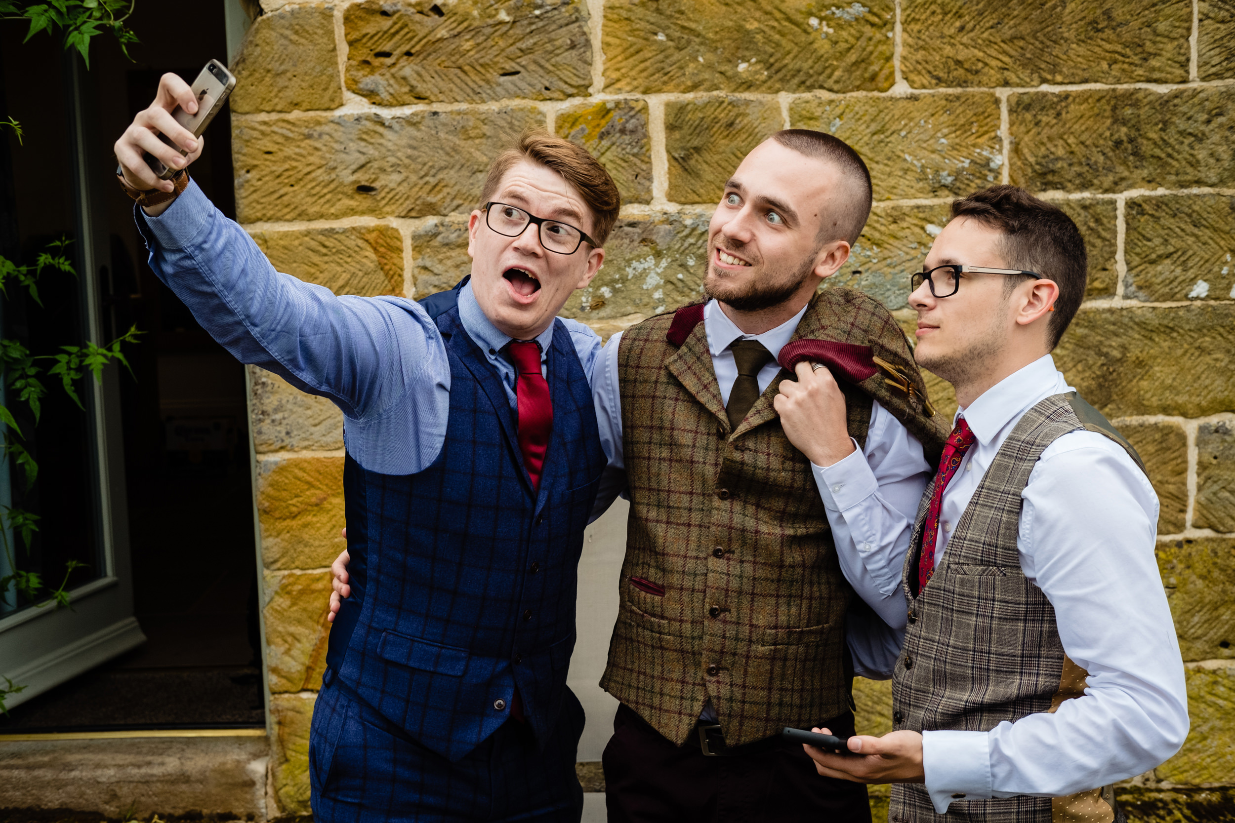 groom and friends taking a selfie. esk valley wedding photography by emma and rich.