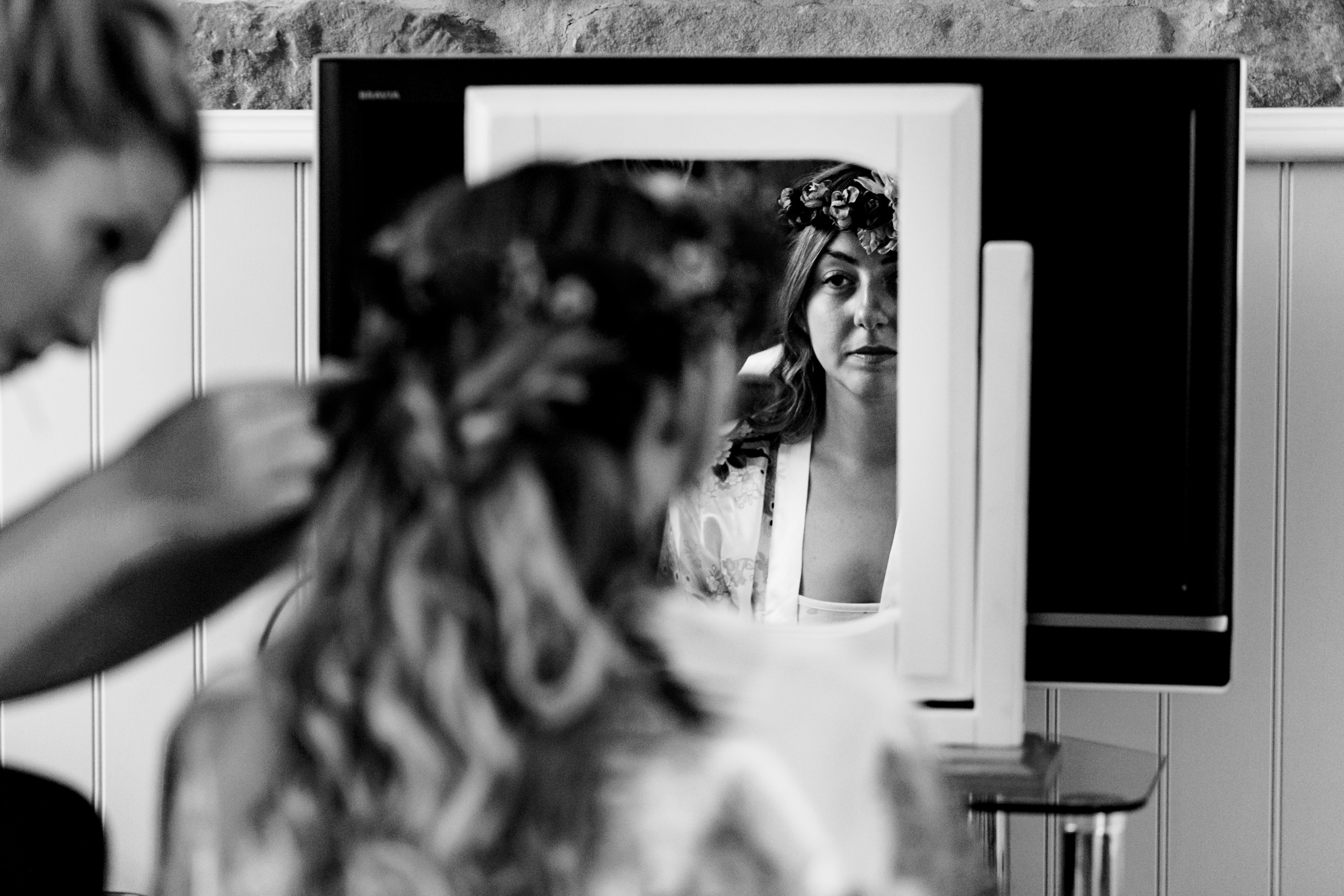 bride having hair done. esk valley wedding photography by emma and rich.