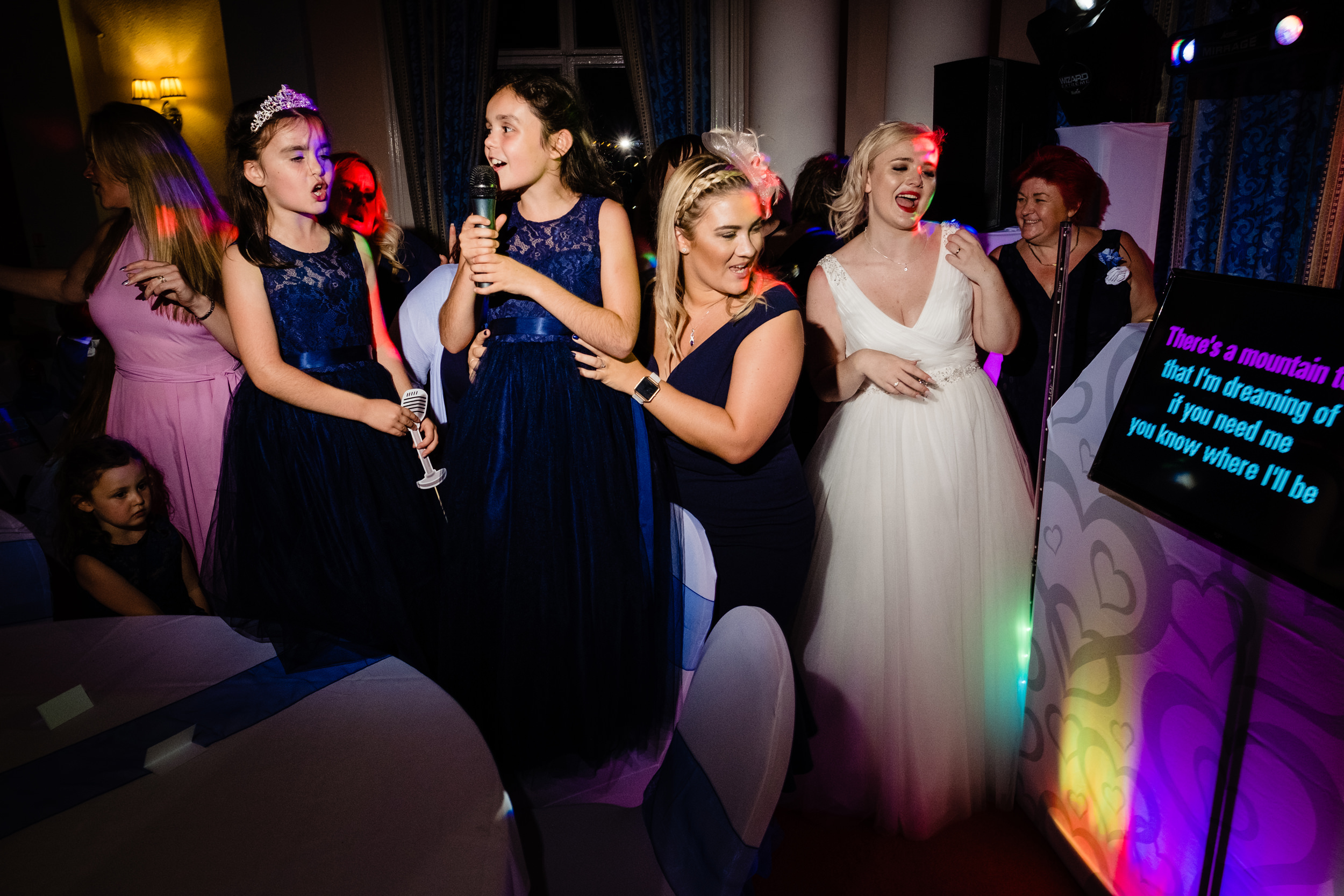 bridal party singing karaoke. grand hotel scarborough wedding photography by emma and rich.