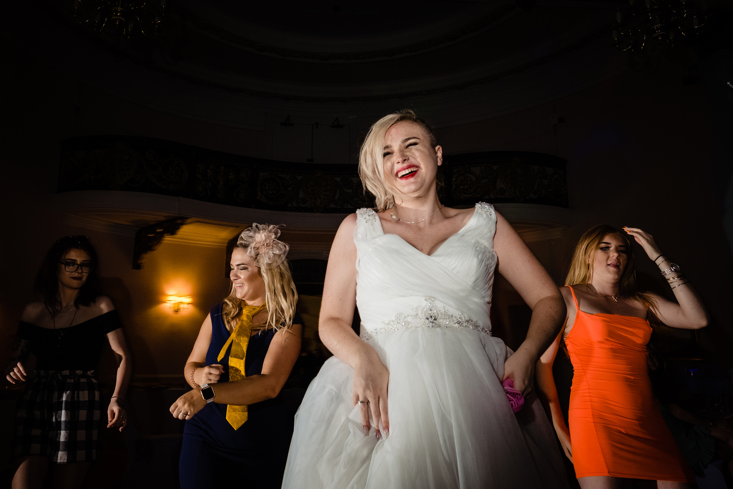 bride dancing with friends. grand hotel scarborough wedding photography by emma and rich.