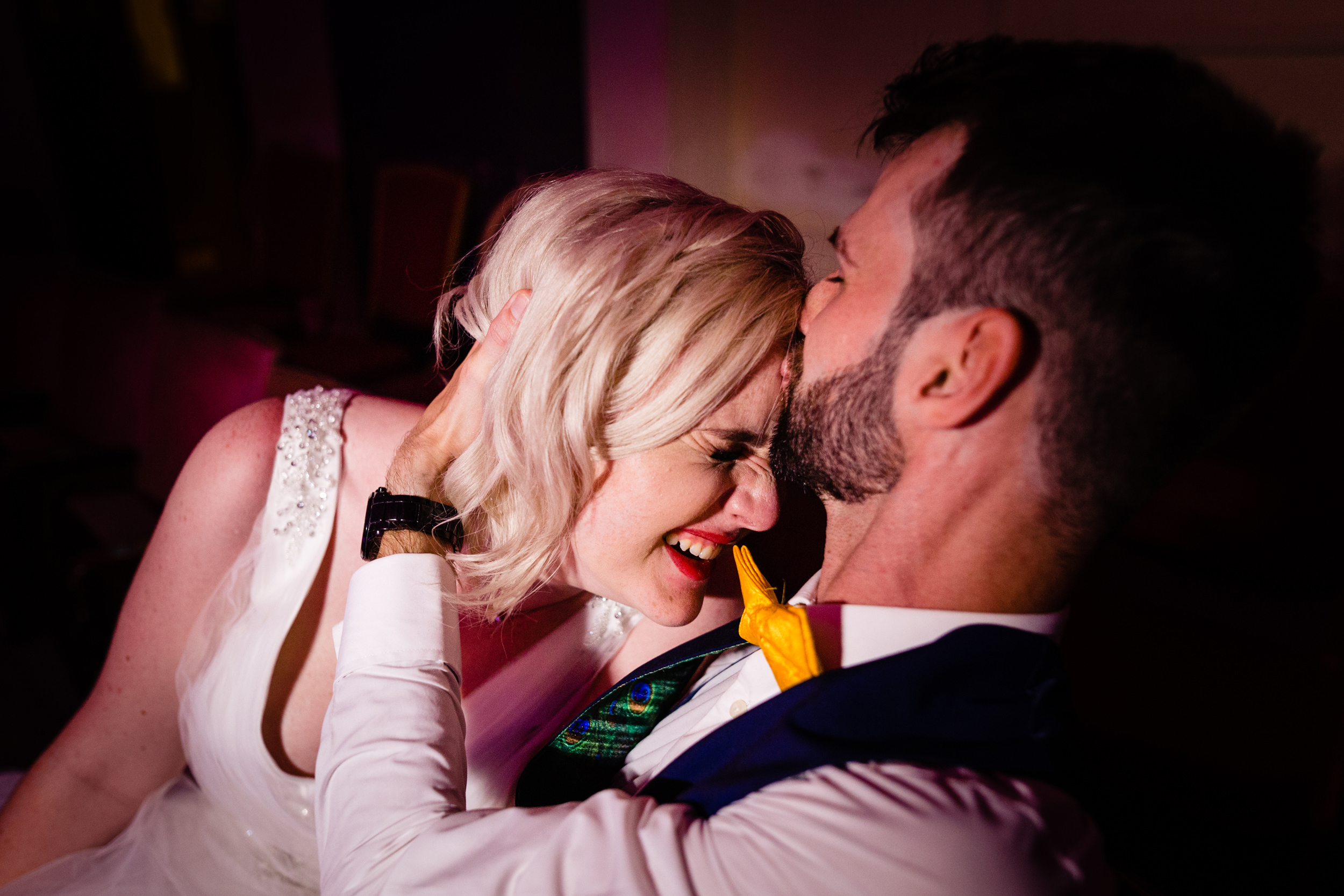 groom kissing bride on head. grand hotel scarborough wedding photography by emma and rich.