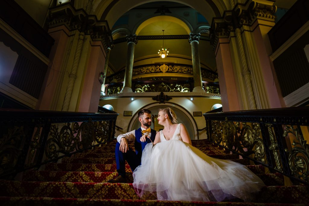 bride and groom sat on the staircase - grand hotel scarborough wedding photography