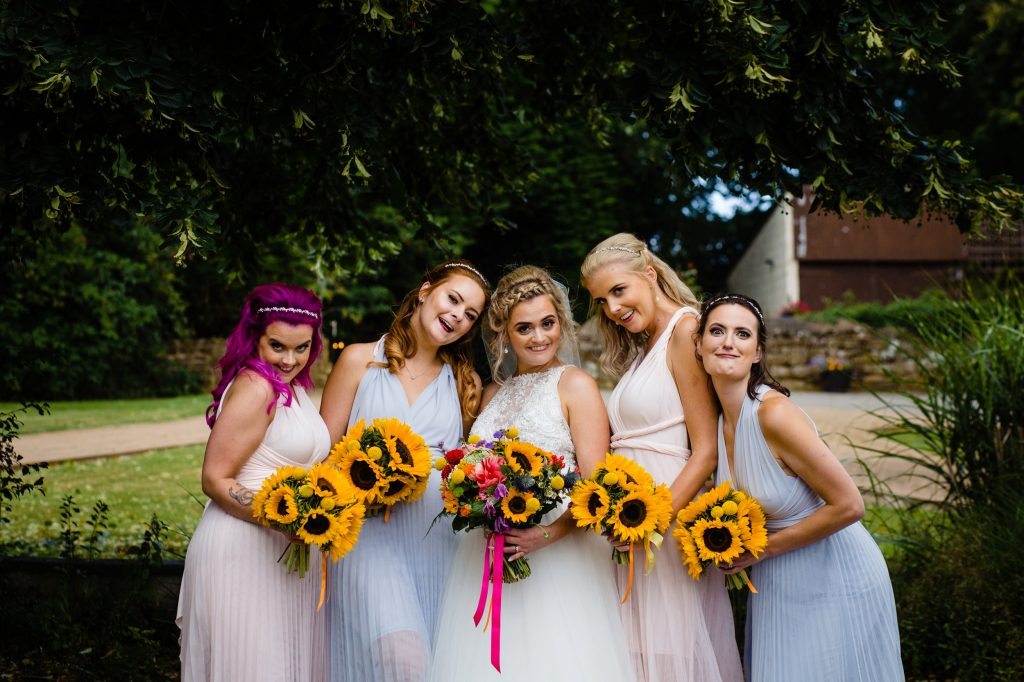 group shot at a dovercote events wedding, fun wedding photography by emma and rich