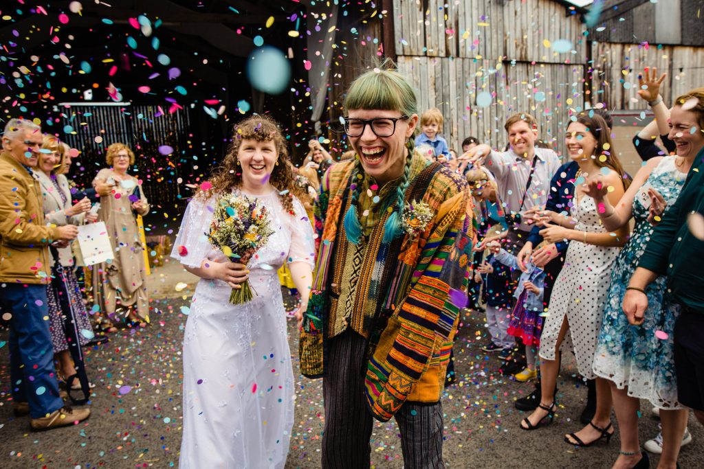 newlyweds being showered in confetti. deepdale farm wedding photography by emma and rich.