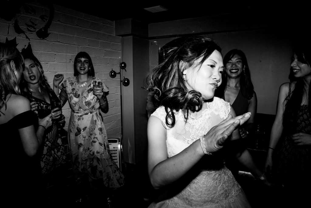 bride on the dancefloor. primrose hill wedding photography by emma and rich