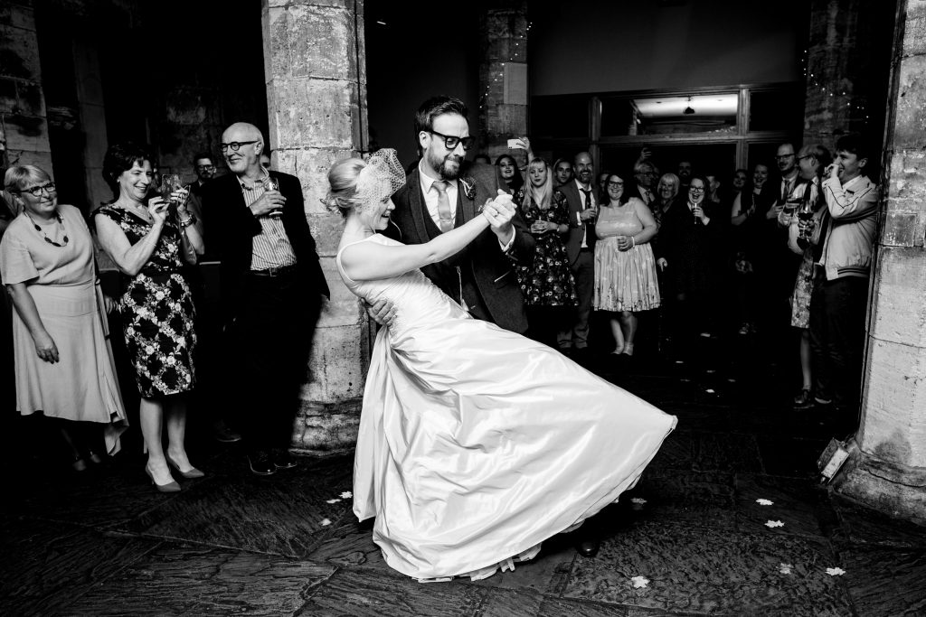 groom dipping the bride on the dancefloor. york wedding photography by emma and rich.