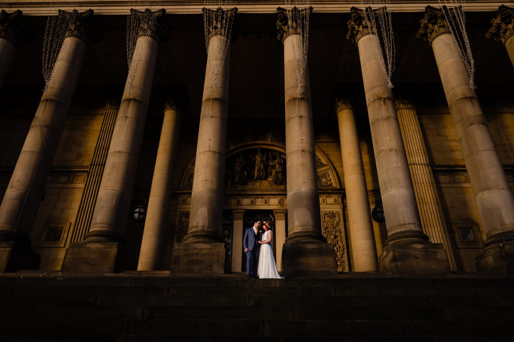 bride and groom on the steps of leeds town hall. leeds wedding photography by emma and rich.