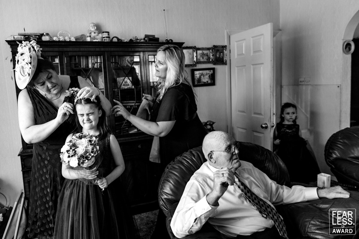 how to choose a wedding photographer. a family prepare for a wedding day whilst grandad watches tv.