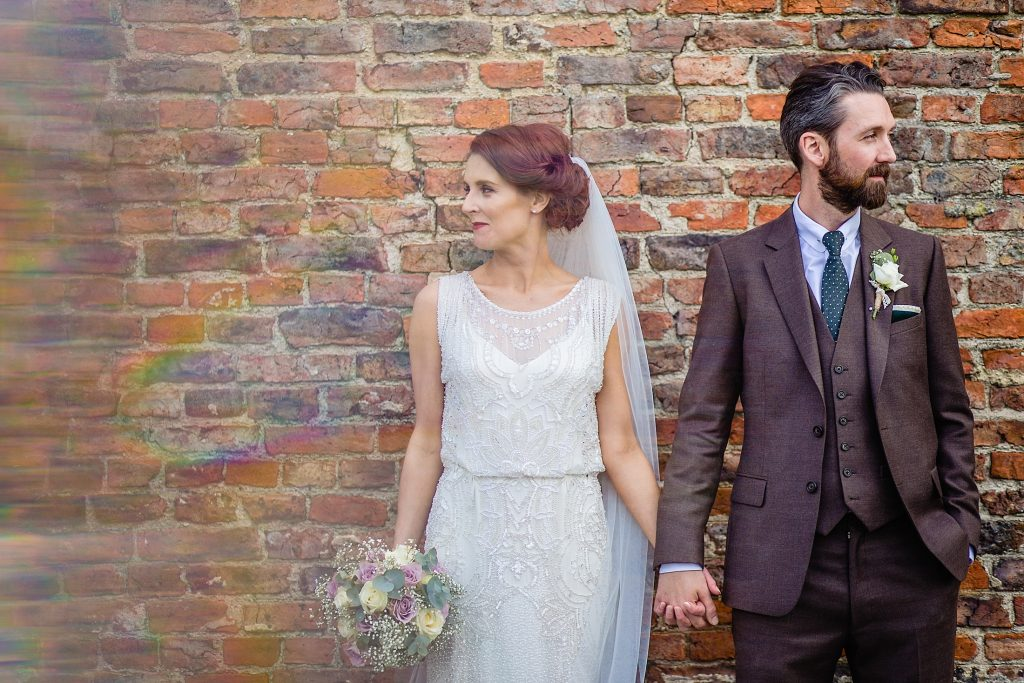 bride and groom looking cool at barmbyfield barns
