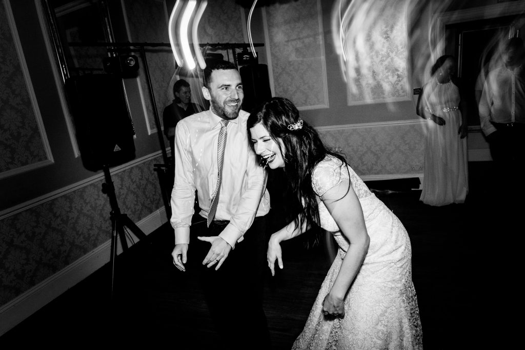bride and groom laughing on the dancefloor