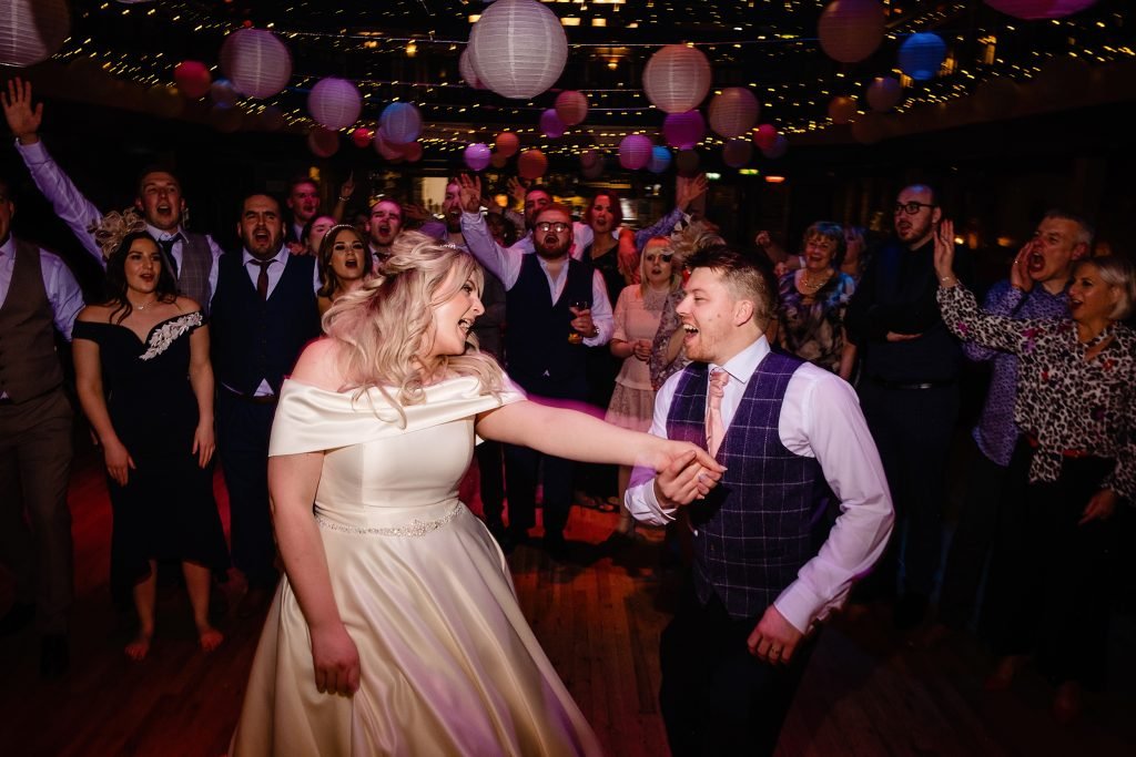 a newly married couple dance at the engine shed in wetherby. photo by emma and rich.